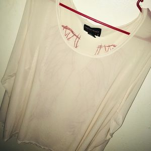 Torrid Ivory mesh top shirt with wings in the back